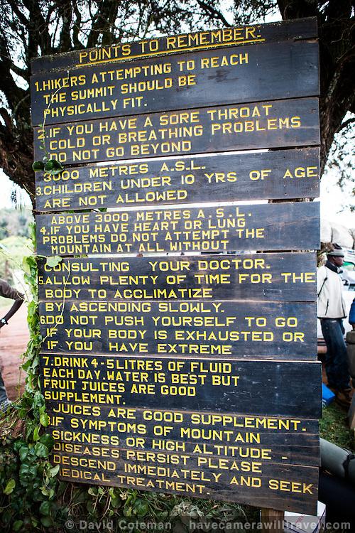 Mt-Kilimanjaro-Warning-Sign-at-Londorossi-Gate-L230074606